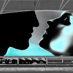 A couple shares a hi-tech kiss.