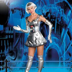 A blond fembot stands in front of a futuristic background.