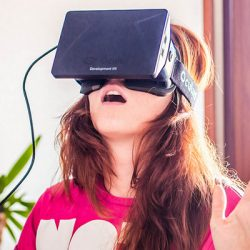 A woman wears the virtual reality headset Oculus Rift.