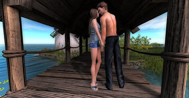 A Second Life couple takes a romantic walk on a boardwalk.
