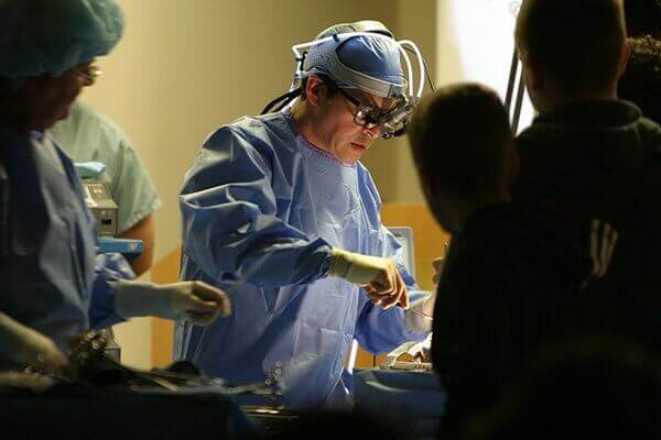 A doctor performs surgery.