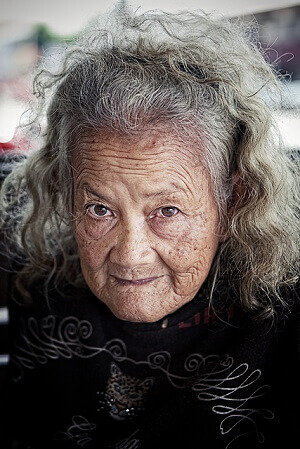 An old woman with grey hair.