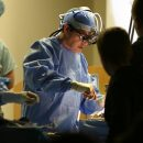 A doctor performs surgery