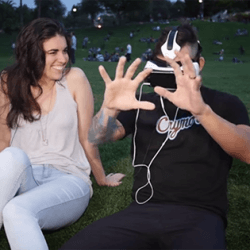 A man watches VR porn next to a woman.