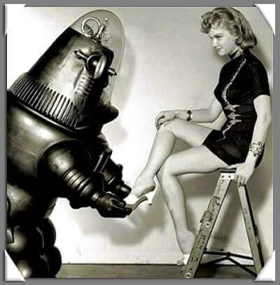 A robot helps a woman put on her shoe.