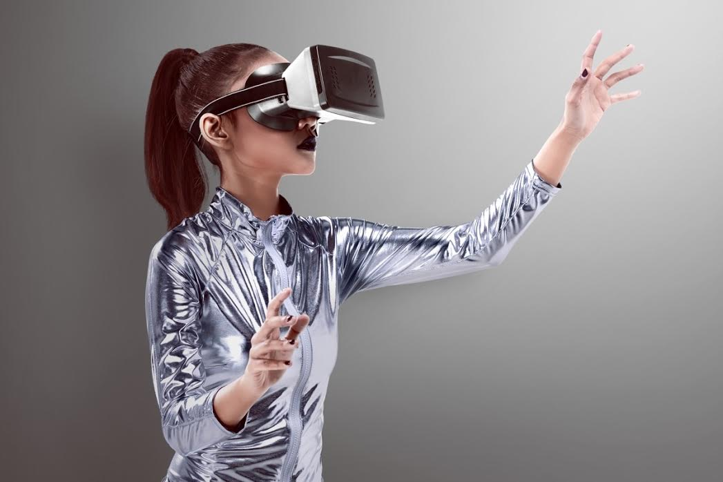 A woman wears a virtual reality headset.