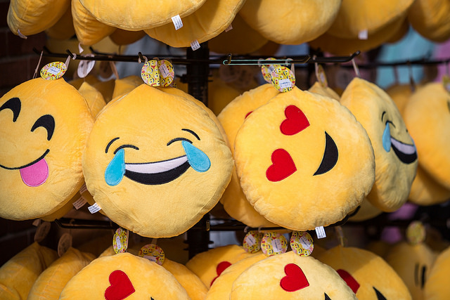 Stuffed plush toys that looks like emojis.