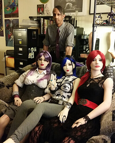 Davecat and his synthetic ladies Shi-chan, Lenka, and Miss Snow.