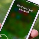 Voice assistant Siri asks if she can help.