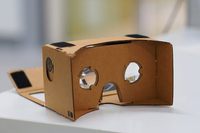 A empty Google Cardboard headset for watching VR videos rests on a counter.