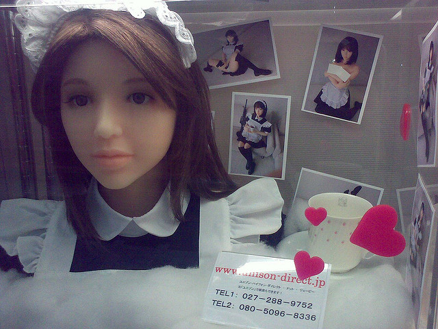 An Asian-looking love doll wearing a maid's outfit.