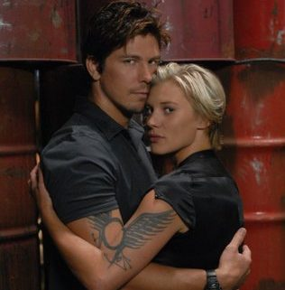 "BATTLESTAR GALACTICA -- Pictured: (l-r) Michael Trucco as Anders, Katee Sackhoff as Kara ""Starbuck"" Thrace."