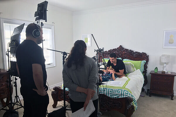 A wide shot a cameras filming a VR adult therapy scene in a bedroom.