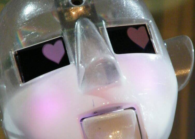 A robot with pink hearts for eyes.