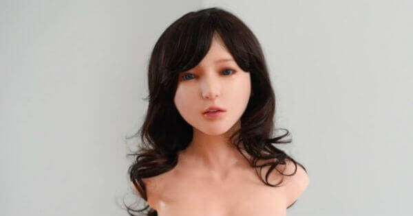 A dark-haired robotic head of a Chinese-made gynoid.