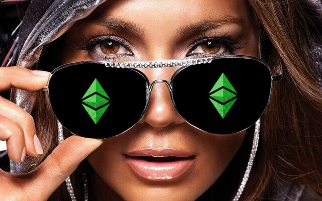 A woman wearing aviatar sunglasses with the Ethereum logo on each lens.
