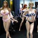 Sex stands are posed standing up while wearing skimpy outfits.