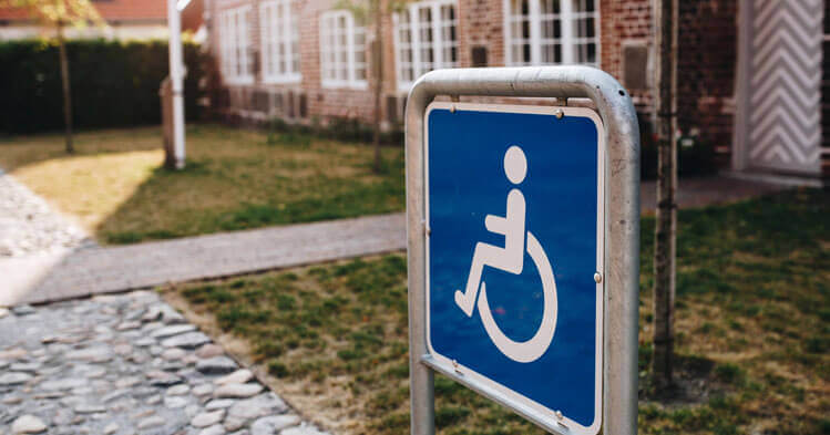 person with disability sign in front of a house