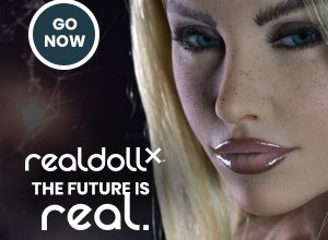 A blonde and light-skinned love doll face sppears next to the text Go now realdollxthe future is real.
