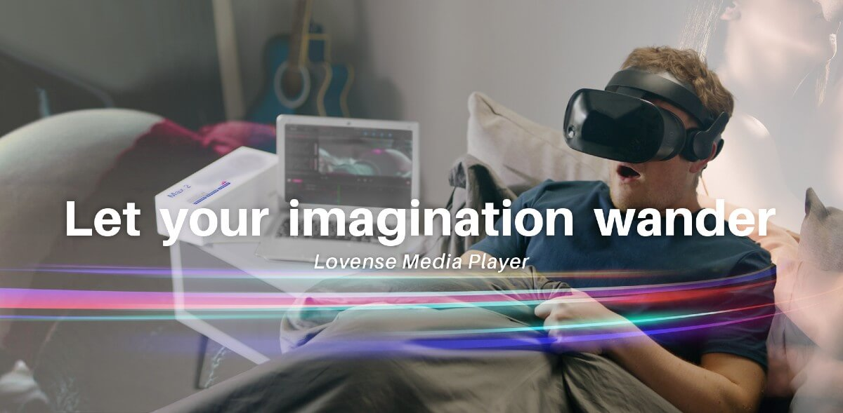 A young white male is shown lying in bed under the covers wearing a VR headset.