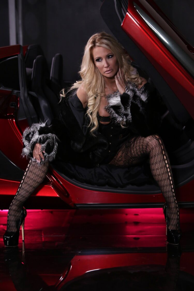 Jessica Drake looking sexy in red sports car