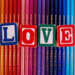 Screenshot showing colorful pencils with LOVE letters engraved on dice