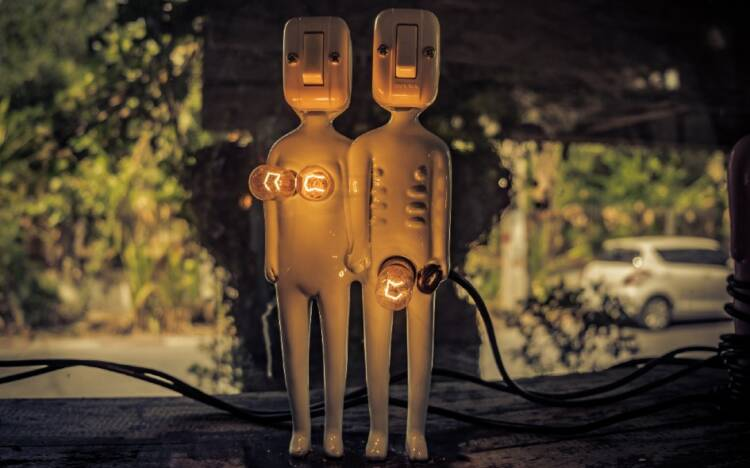 Two humanoid-looking lamps show light bulbs to represent breasts and the genital area.