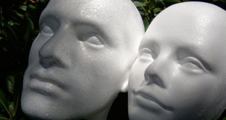 Screenshot of Styrofoam Faces of Male and Female In the Garden
