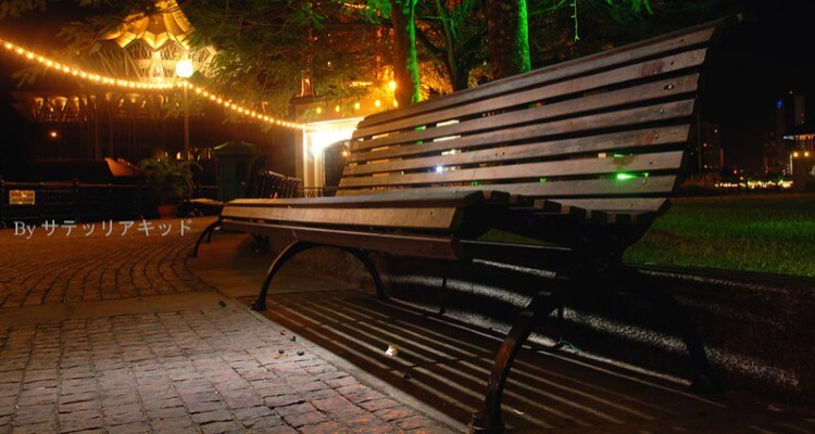 Image of Empty Bench in a Park with Beautiful Outdoor lights Display in Background