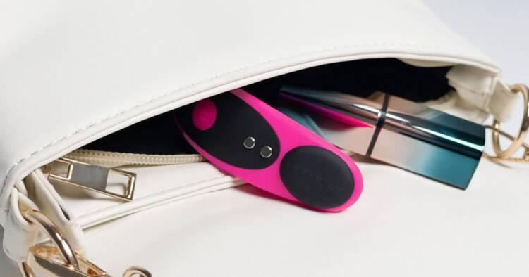 Image of Open Handbag with Lipstick and Lovense Ferri Device