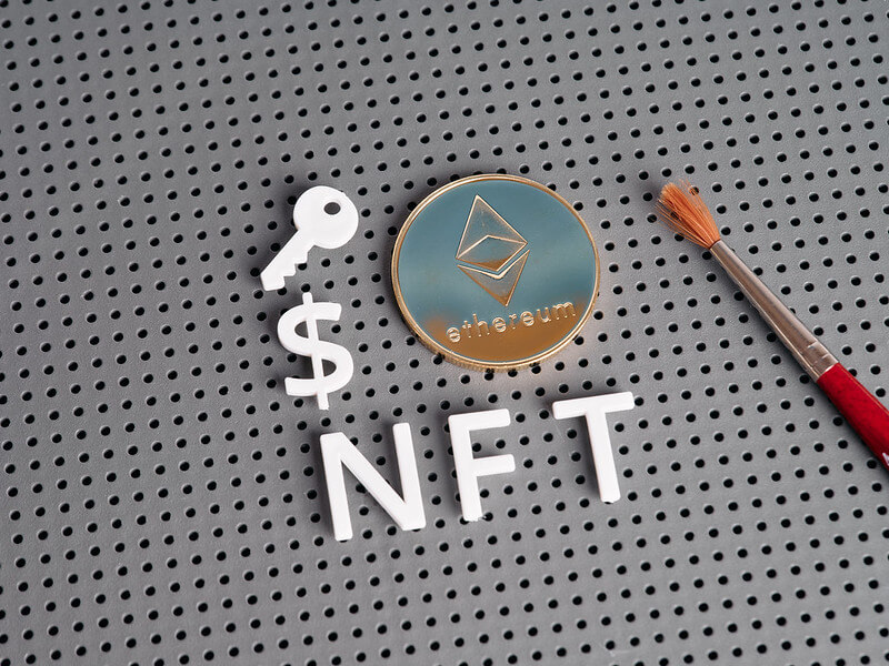 NFT letters with Ethereum-style coin and paintbrush