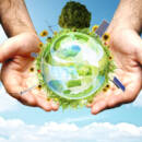 hands holding green orb with green energy