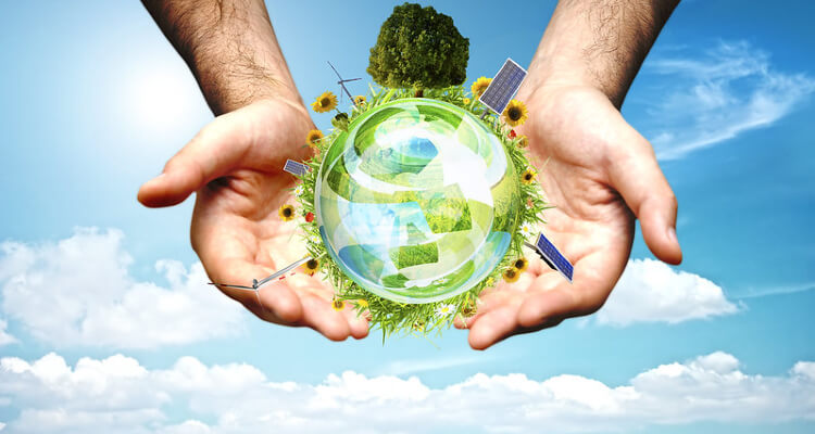 Hands holding green globe, clean energy