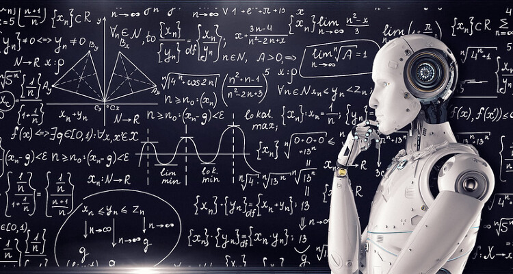 Robot standing in front of a board covered with equations (attribution: Mike MacKenzie)